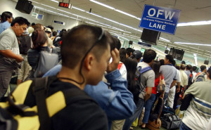 A long line of returning Filipino workers queue on a special immigration lane for Overseas Filipino Workers (OFW) on arrival at Manila airport, 08 April 2006.  Cash transfers to the Philippines by its large work force abroad rose to 10.8 percent in the first four months but they tailed off in April as less Filipinos were deployed overseas, the Central Bank said 15 June 2006. The government expects the full-year total to be at least 10 percent above the record remittances of 10.7 billion USD in 2005.  AFP PHOTO / ROME GACAD
